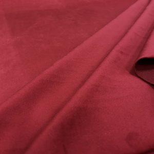 Velours ras uni couleur rouge théâtre