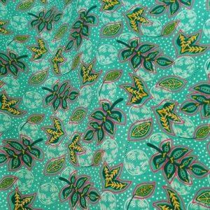tissu coton imprimé BIO et OEKOTEX motifs feuilles stylisées sur fond vert