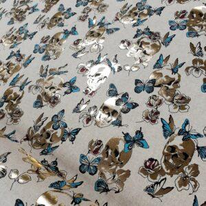 tissu coton imprimé motifs crânes vanity col bleu et doré